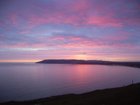 Sandown Bay from Culver Cliff at Sunset (the dark speck is a raven!)